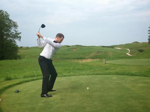 Dr Thomas Oliver teeing off on his wedding day